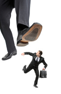 stock-photo-12686598-afraid-businessman-running-away-from-a-big-foot