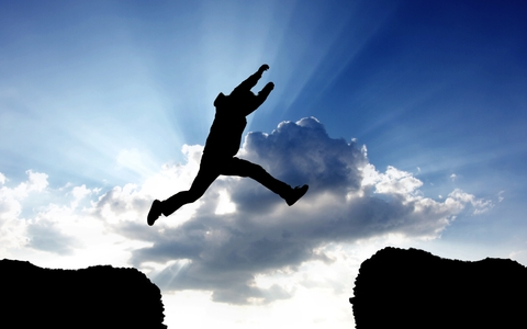 http://www.dreamstime.com/royalty-free-stock-photos-man-jumping-gap-sky-image30216068
