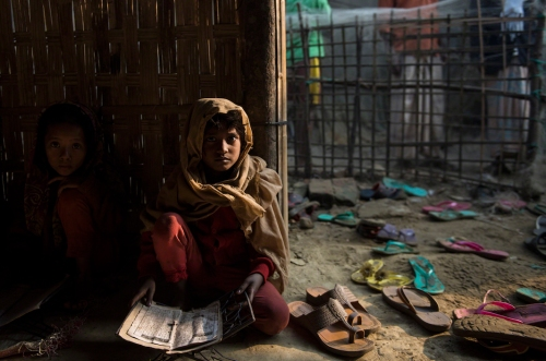 Lynsey Addario 2016 Shamlapur, Bangladesh A Rohingya child reads the Koran at a madrassa in a mosque. There are very few opportunities for Rohingya children to attend school, but most children receive some education by studying the Koran at the local madrassa.
